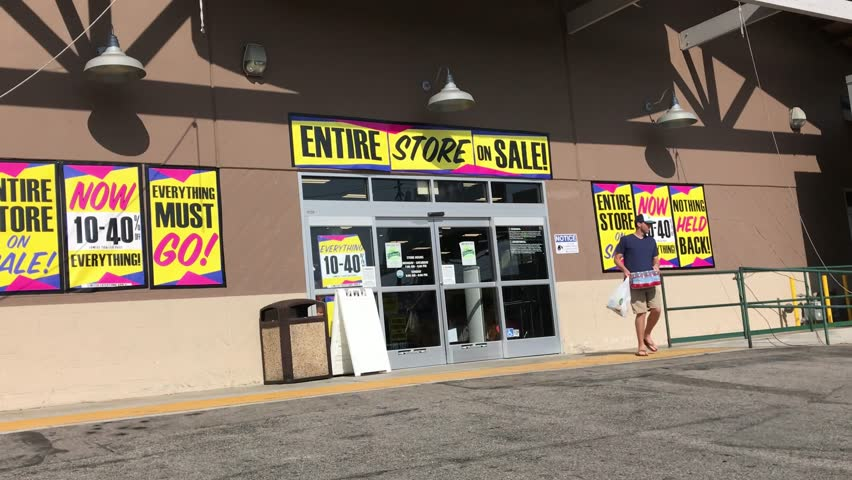 LOS ANGELES, Sep 1, 2018: Pan up from entrance of an OSH Orchard Supply Hardware store surrounded with final sale signs, to store sign above entrance. The chain is set to close for good Oct 20th.
