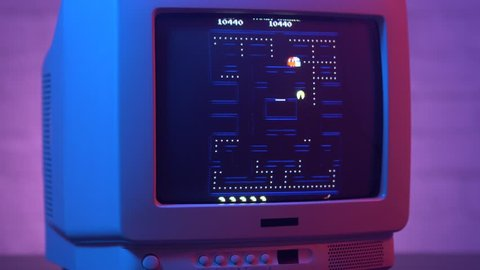 MONTREAL, CANADA - September 2018 : Famous Pac-man video game being played on a old vintage TV screen 80s 90s style.