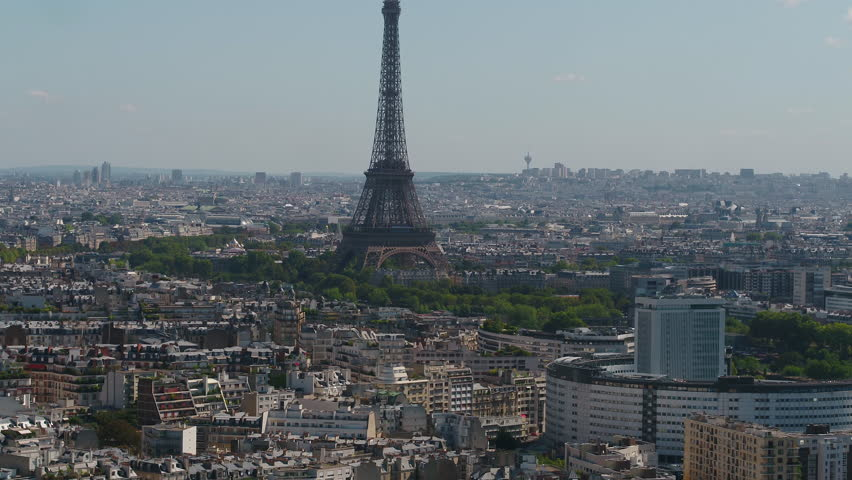 Aerial video of the Eiffel Tower on a sunny day with a zoom lens in Paris France. | Shutterstock HD Video #1015903603