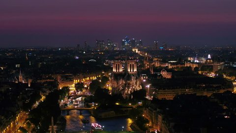 Aerial video of Notre Dame and La Seine waterfront in Paris France during a beautiful sunset evening zoom lens