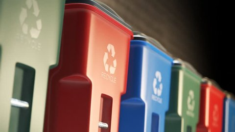 Colorful, plastic garbage bins, with recycle logo on the front, stacked in a row against a brick wall in an endless, loop. Symbol of recycling, waste sorting, ecology and saving the environment.