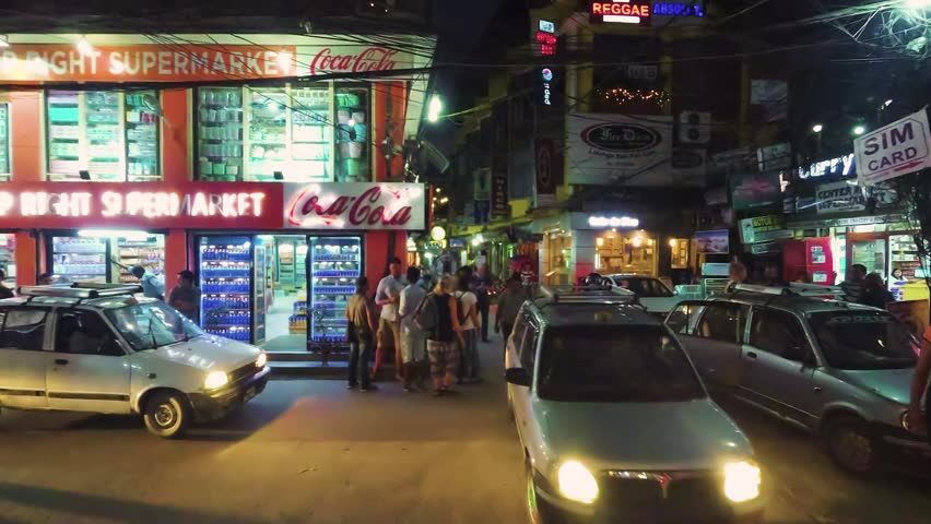 Nepal , Kathmandu - November 04, 2017: Street with cars and people in the asian town at night