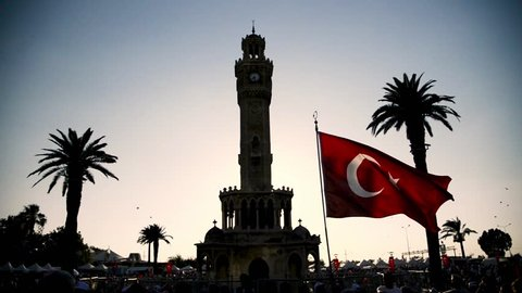 Izmir, Turkey - June 15, 2018: June 15 Day of Democracy in Turkey Izmir. People holding Turkish flags at Konak square in Izmir and in front of the historical clock tower.
