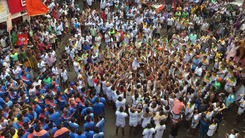 Mumbai /India 03 September 2018 Devotees try to form a human pyramid to break a clay pot during Dahi Handi celebrations at Dadar Mumbai Maharashtra India #1015967293