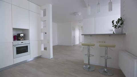 Open space with living and kitchen. Marble kitchen and large pantry. Nobody inside