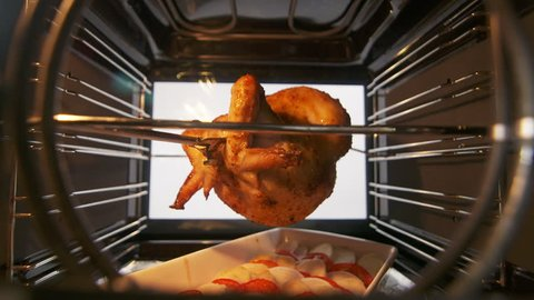 Cooking spit roasted whole chicken grilled in the oven