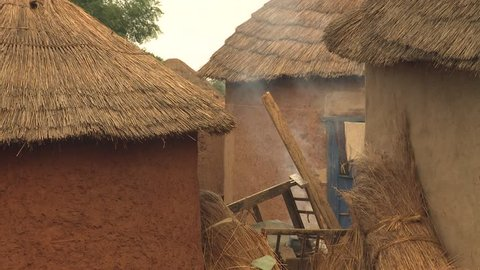 African village of huts and earth houses.