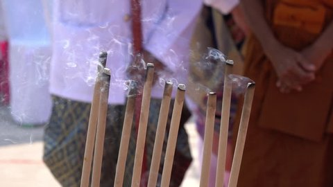 Close up of burning joss sticks