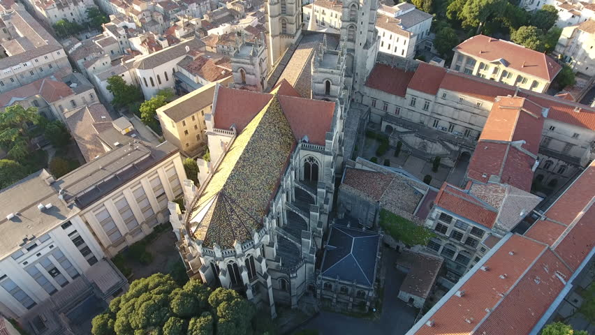 Aerial drone shot of Montpellier cathedral during sunrise.