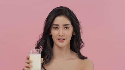 Attractive Asian woman drinking milk.