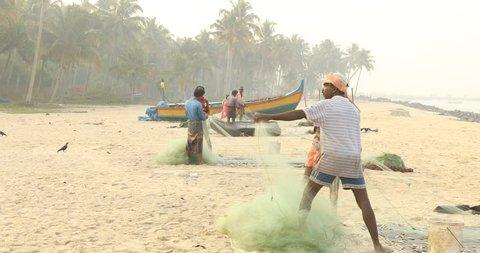 Fishermen in beach Kerala India 19th Feb 2018