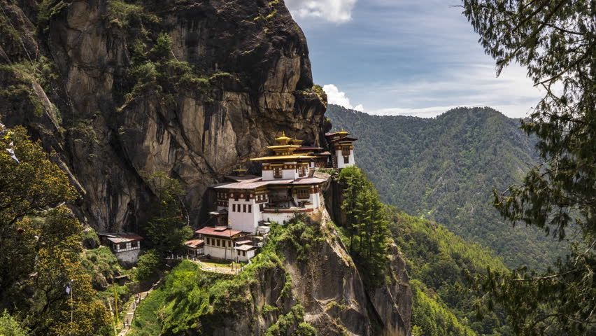 4K Timelapse movie video film of Taktshang Goemba or Tiger's nest Temple the beautiful buddhist temple.The most sacred place in Bhutan is located on the high cliff mountain with sky of Paro valley