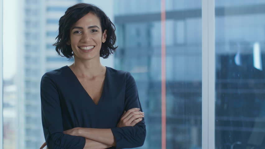 Portrait of the Successful Hispanic Businesswoman Crossing Her Arms and Smiling. Beautiful Female Executive Standing in Her Office. Shot on RED EPIC-W 8K Helium Cinema Camera. | Shutterstock HD Video #1016145793