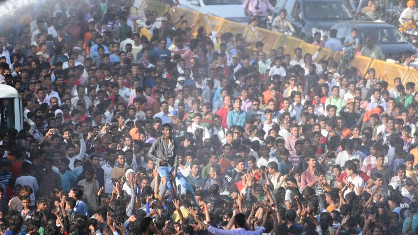 AMRAVATI, MAHARASHTRA, INDIA 3 SEPTEMBER 2018 : Crowd of young of People gather together and dancing on road during the Dahi Handi festival to celebrate God Krishna's Birth.  | Shutterstock HD Video #1016157163