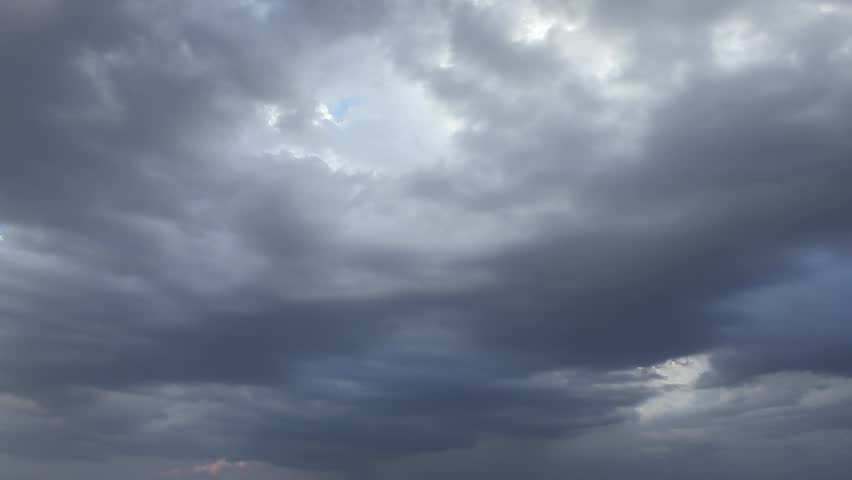 Rain dark thunderstorm rolling clouds, fast motion, moving, beautiful nature colors, stormy angry cloudscape, supercell, tornado formating time. Time lapse. | Shutterstock HD Video #1016227033