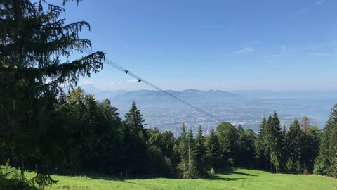 View from the mountain Pfaender in Austria on Lake Constance with cable car passing by