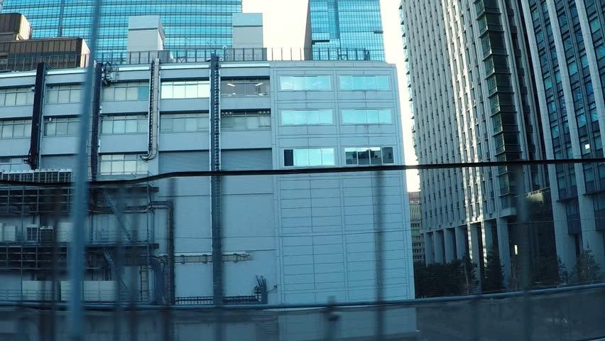 Japanese cityscape. Capital highway, a car window near Yaesu.