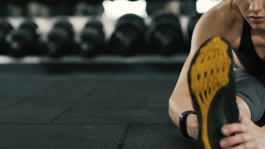 7ea37583106 Young girl doing stretching exercises in gym, healthy lifestyle, physical  training concept, close up, camera slides from left to right