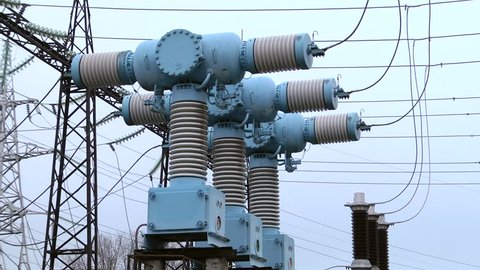 Air high-voltage switches. Electrical poles with wires and insulators at the electrical substation. High-voltage SF6 circuit breaker. High voltage switch.