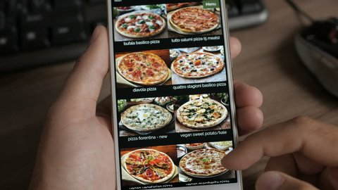 Man Orders Pizza Using Online Delivery Service With Smartphone. Close Up. 4K UHD.