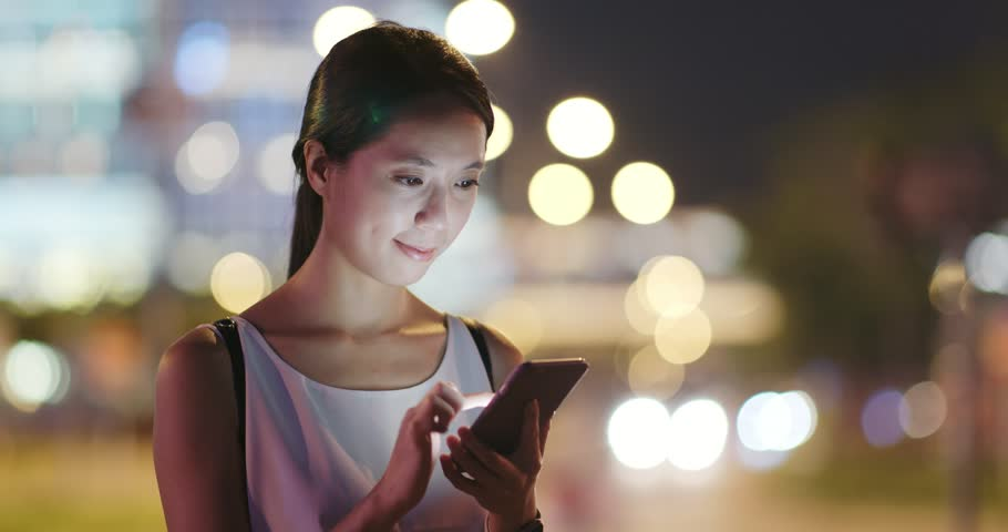 Woman use of mobile phone for order taxi at night | Shutterstock HD Video #1016429803