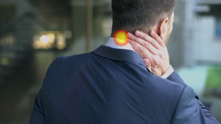 Man suffering from neck pain, muscle spasm, spot indicates inflammation, slow-mo | Shutterstock HD Video #1016455843