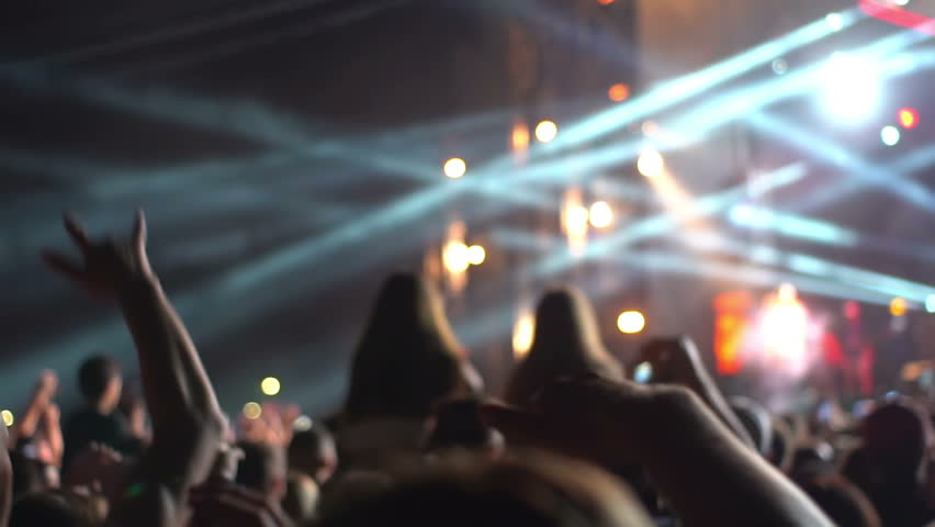 Footage of a crowd partying at a rock concert hand phone | Shutterstock HD Video #1016461603