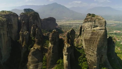 View from above landscape amazing valley and small town or city Kalabaka surrounded by high great mountains and cliff Meteora aerial shot beautiful natural scenery in Greece