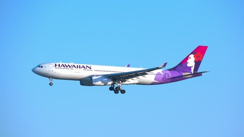 NEW YORK - 2018: Hawaiian Airlines Airbus A330-200 Commercial Jet Airplane on Final Approach into JFK Airport on a Sunny Day with a Blue Sky Background