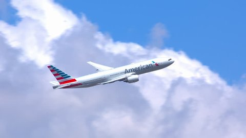 NEW YORK - 2018: American Airlines Boeing 777-200 Commercial Jet Airplane Flying in a Cloudy Sky after Taking Off from JFK International Airport