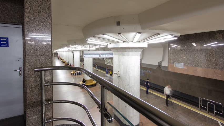 An underground train departing from Oleksievska metro station on Oleksievska Line of Kharkiv metro timelapse hyperlapse, with a passengers on a platform, in Kharkov, Ukraine
