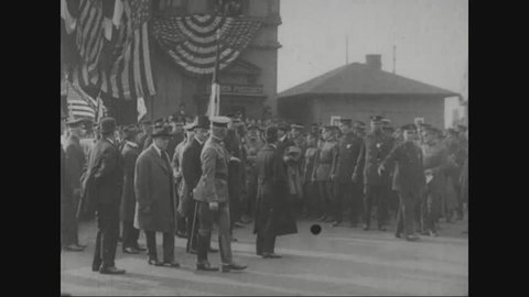 CIRCA 1920s - Marshal Ferdinand Foch is greeted by the American Legion upon arrival and he is driven in a parade.