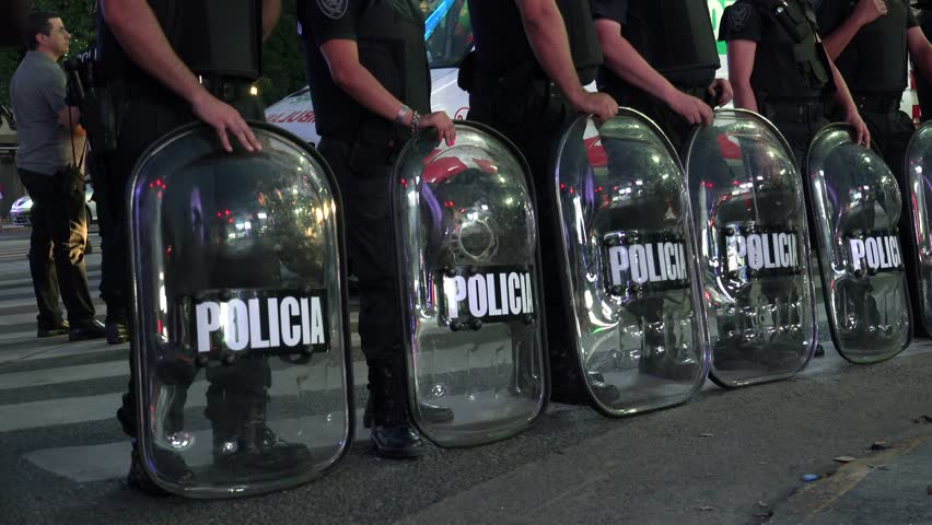 Buenos Aires, - FEBRUARY 23: Line of police with shields during Buenos Aires citizens social protest. February 23, 2018 in Buenos Aires, Argentina