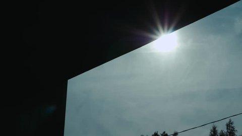 Opening warehouse door service factory morning sun flares