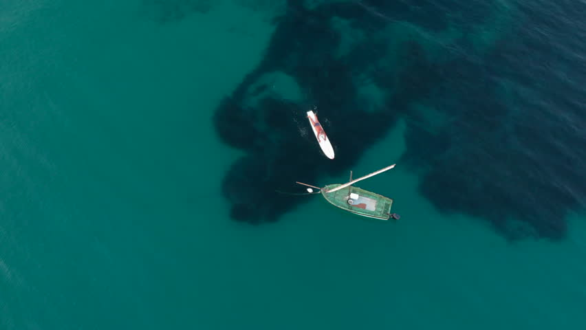 Aerial view of a fishing or travel boat near the shore in Aegean sea in Greece  | Shutterstock HD Video #1016618173