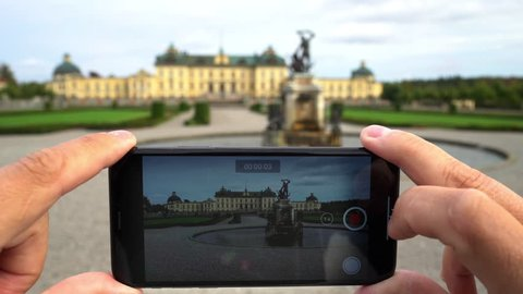 DROTTNINGHOLM - SEPTEMBER 20, 2018: Drottningholm Palace, Stockholm, seen through a smartphone display