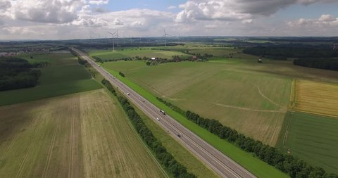 Autobahn and wind power plant in Bavaria, Germany with pan to the right