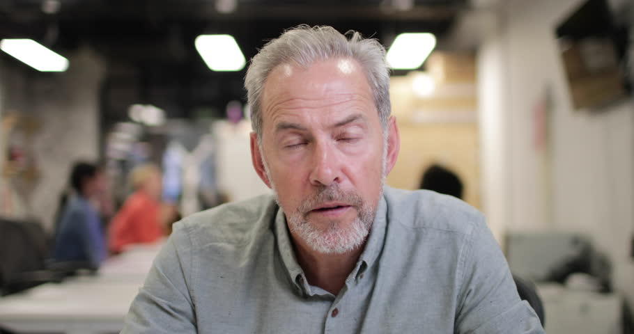 Mature businessman on a videocall in an office | Shutterstock HD Video #1016672383