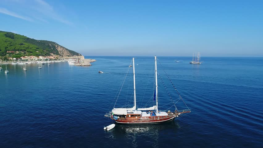 Sailboat in the Mediterranean sea, Island of Elba in Italy. Holidays in Italy