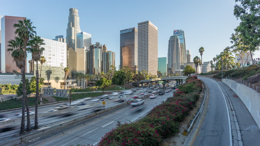 Los Angeles, California, USA - September 11th 2018 - Downtown Los Angeles Skyline and 110 Harbor Freeway Day Timelapse