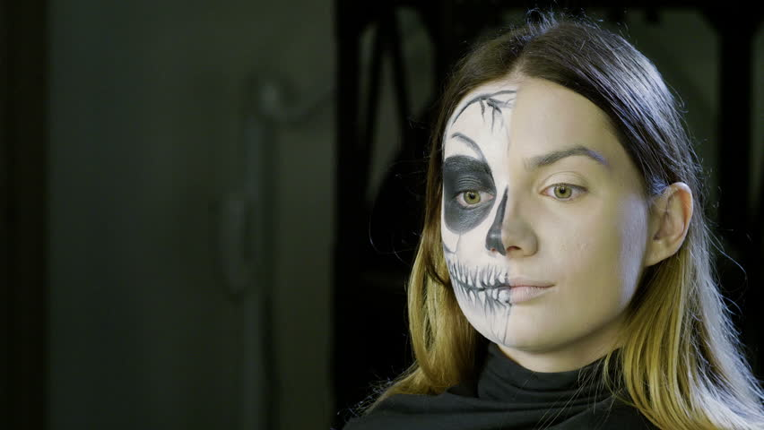 Make-up artist is making blonde woman up as dead bride for halloween party. 4K | Shutterstock HD Video #1016853853