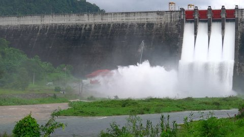 Dam with floodgate, Dam with water overflow, Spillway on the Khun Dan Prakan Chon Dam in Thailand.