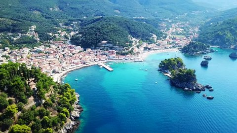Aerial drone bird's eye view video from iconic and picturesque village of Parga with famous medieval uphill castle, Epirus, Ionian, Greece