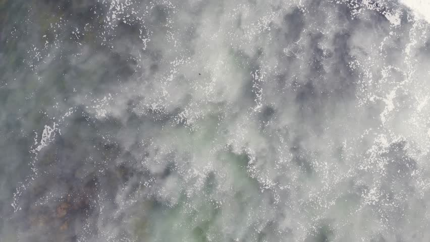 Aerial view of Atlantic Ocean, Portugal coast, with the Giant Waves, Foaming and Splashing in the Ocean, Sunny Day, Slow Motion Video shot from drone | Shutterstock HD Video #1016897353