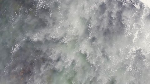 Aerial view of Atlantic Ocean, Portugal coast, with the Giant Waves, Foaming and Splashing in the Ocean, Sunny Day, Slow Motion Video shot from drone
