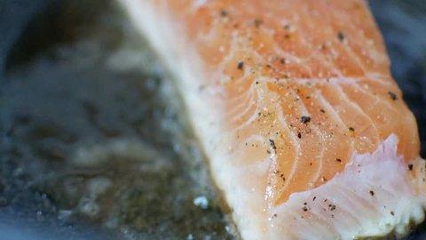 Fresh norwegian orange salmon fish filet was fried in the pan for salmon steak