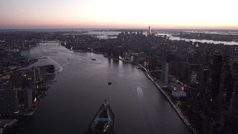New York City Circa-2015, Aerial view of New York's skyline at dusk from above Roosevelt Island, featuring Midtown and Lower Manhattan, Long Island City and Brooklyn