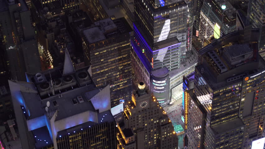 New York City Circa-2015, telephoto aerial view flying parallel to Broadway and Times Square at night. #1017004783