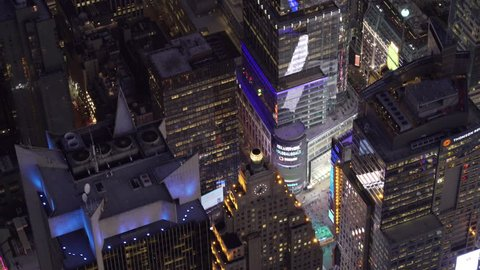 New York City Circa-2015, telephoto aerial view flying parallel to Broadway and Times Square at night.