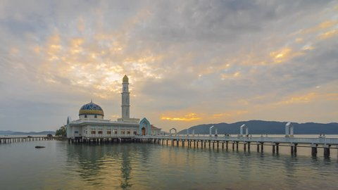 Beautiful time lapse of floating mosque at sunrise from night to day at dawn in an island. Masjid 1000 Selawat, Pangkor, Malaysia. Prores 4K.